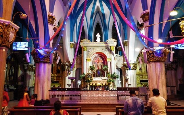 People praying inside the beautiful 17th century catholic St. Mary's Basilica in Bangalore.