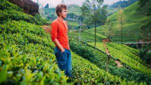 A young man relaxing in Munnar tea estate