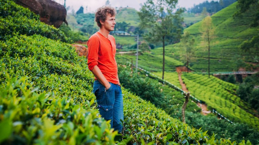 A young man relaxing in Munnar tea estate