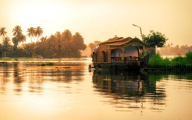 A well decorated houseboat parked at sides of backwater canal at Alleppey in Kerala