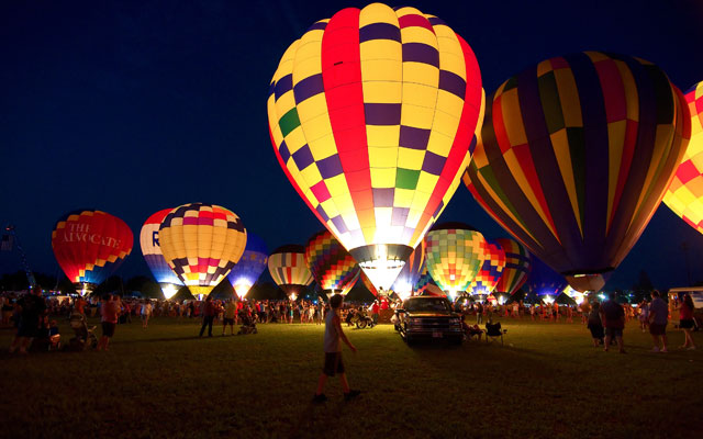People prepare for the glowing of the balloons at the annual Hot Air Balloon Festival in Araku, Andhra Pradesh.
