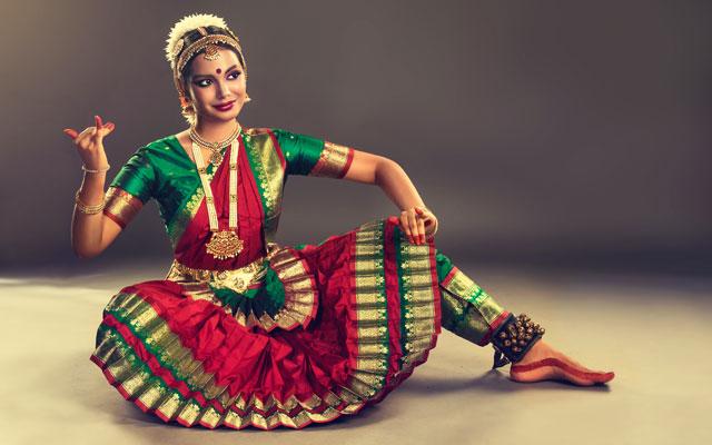 A young girl performing Bharatanatyam dance