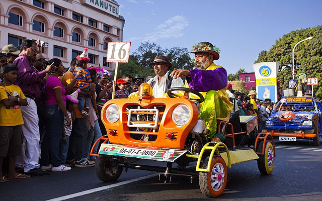 People driving on the vintage cars at the traditional procession in Goa carnival, Goa