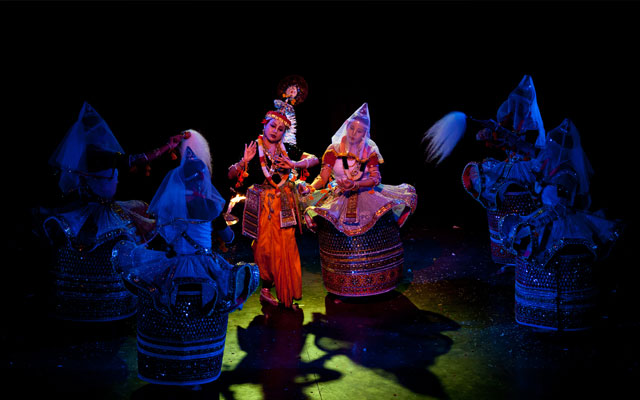 Indian classical dance Manipuri preformance. Female is portraying Krishna character
