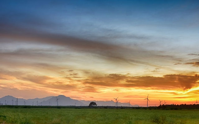 Windmills in the backdrop of a magical sunset in Pollachi, Tamilnadu.