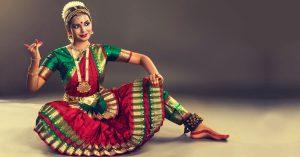 A young girl performs Bharatanatyam