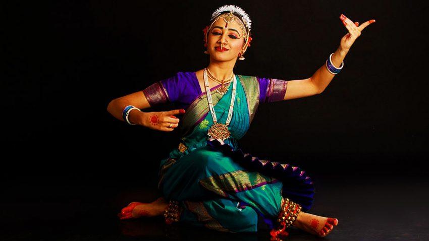 Young woman performing Bharatnatyam