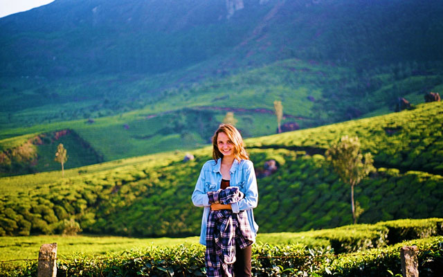 Woman standing on the background of tea plantation in coorg