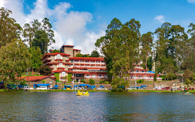 A couple of boats are seen rowing visitors to the town around the Kodaikanal lake.