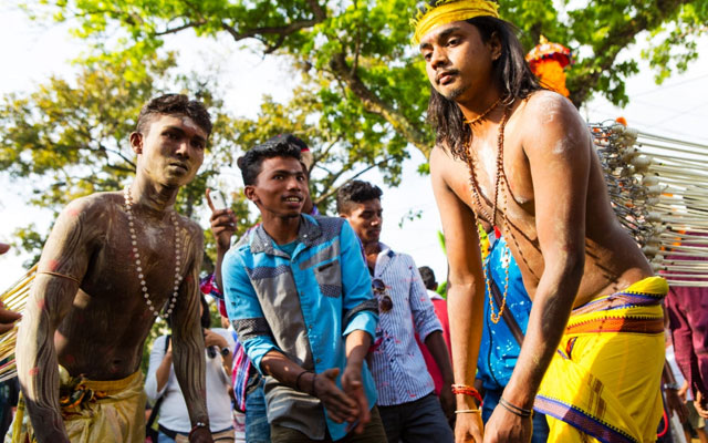 devotees at the extreme Hindu celebration pierce their cheeks with spears or put hooks in their skin to show their devotion.
