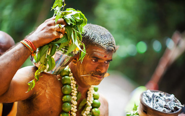 Hindu man carrying Kavadi during Thaipusam festival
