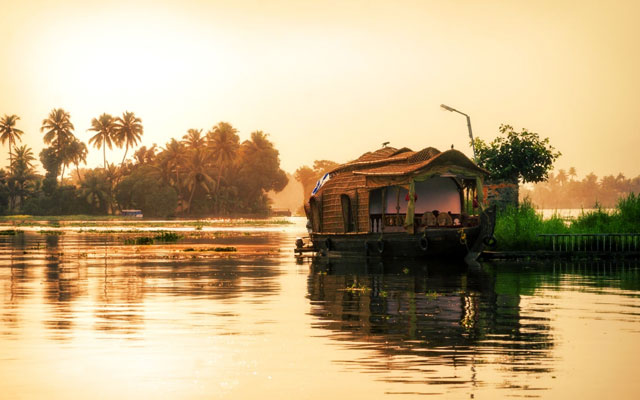 A well decorated houseboat parked at sides of backwater canal at Alleppey in Kerala.