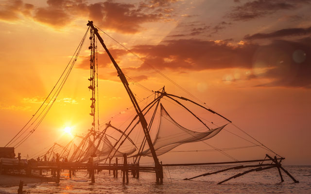 A beautiful view of Chinese fishing net with sunset in Kochi