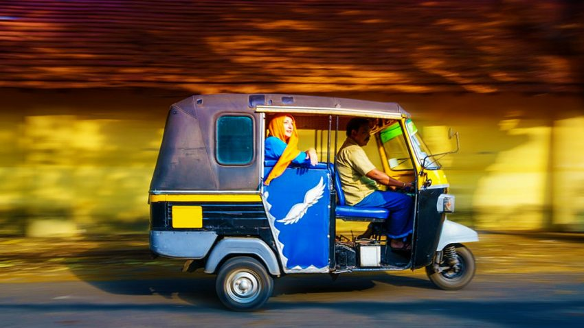Woman riding a tuk tuk taxi in Fort Cochin, India