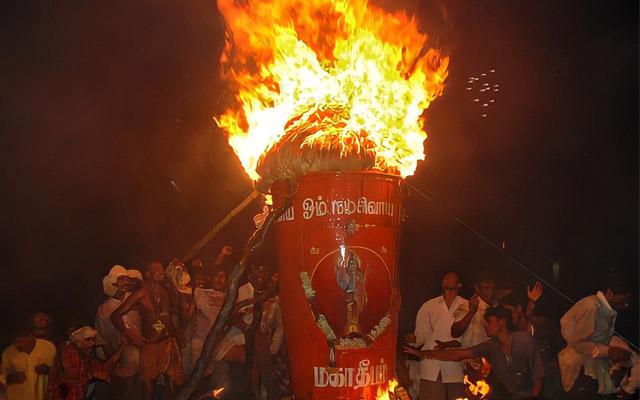 A glimpse of people lightning the Tiruvannamalai Maha Deepam on the auspicious day of Karthigai.