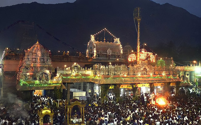 Thousands of devotees throng during the procession of Karthigai Deepam in Tiruvannamalai Arunachaleswarar Temple