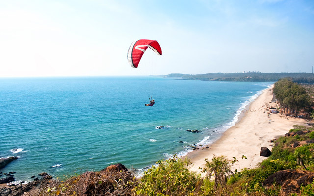 Para glider and Beautiful Tropical beach Querim in sunset ,Goa, India