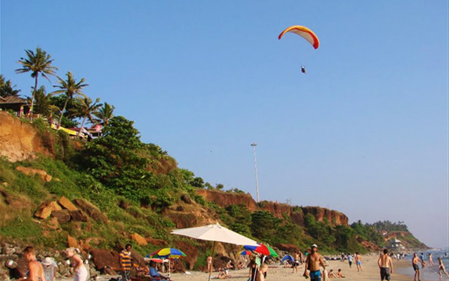Paragliding activity in Varkala near the Varkala cliff beach in the state of Kerala.