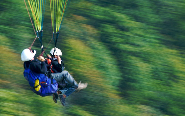 A glimpse of young adventure freaks flying in the thrilling paragliding ride  through the dense Yelagiri mountain valleys.